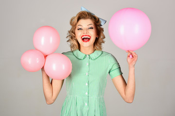 Young woman wearing green old-fashion clothes in pinup style