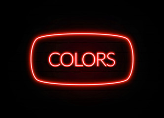 Colors neon sign on brick wall background.