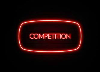Competition neon sign on brick wall background.