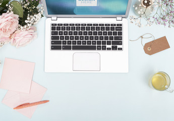 Laptop with Flowers and Stationery Mockup 1