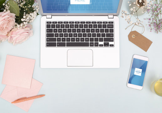 Laptop and Smartphone with Flowers and Stationery Mockup 1