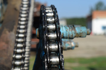 Lubricated salidolom chain chain transmission. Elements of agricultural machinery.