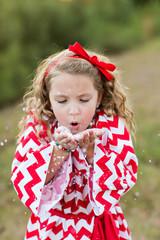 A Little Girl Making it Snow