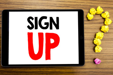 Writing text showing Sign Up. Business concept for Member Register Registration written on tablet computer on the wooden background with question mark made of folded paper.
