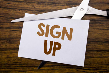 Hand writing text caption inspiration showing Sign Up. Business concept for Member Register Registration Written on note, wooden back with colourful scissors meaning destroy stop of something.