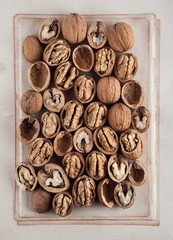 Beautifully presented walnuts on old book pages can be used as background