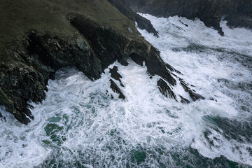 Cliffs at Mizen Head signal station on the south Ireland coast during heavy storm and crashing waves