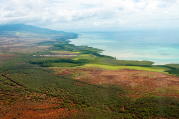 Aerial view of the colorful coast and Pacific water of the island of Molokai, Hawaii