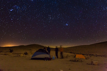 Night camping tents people talk, night stars sky.
