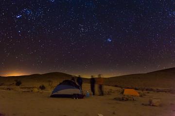 Night camping tents people talk, night stars sky.