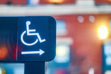 Wheelchair sign pointing right