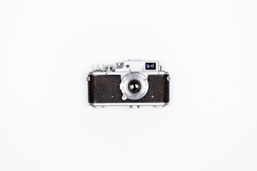Retro photo camera on white background Minimal hipster flat lay.