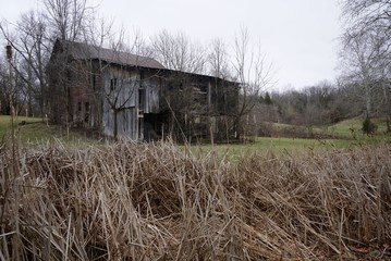 Abandoned old barns in the country on farms