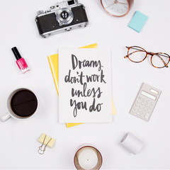 Woman workspace with handwritten quote notebook, vintage camera, coffee cup, nail polish, stationery and candles. on white background. Flat lay, top view. stylish female blogger concept.