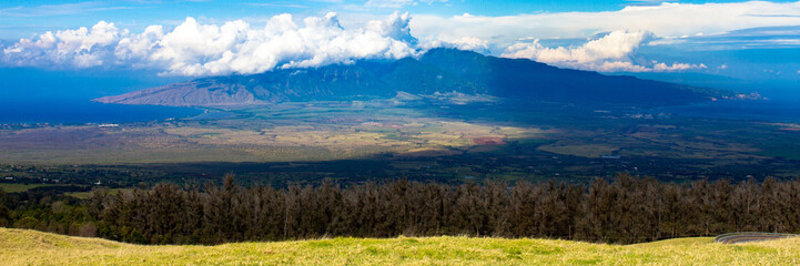 Grand panorama of Kahului Bay on the right, Maalaea Bay on the left, and Puu Kukui, the smaller volcano on the island of Maui in Hawaii, as seen from Haleakala, the larger volcano on Maui