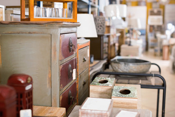 Image of modern furniture shop with wooden chest of drawers