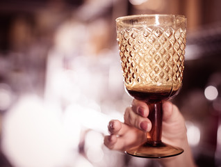 hand with crystal glass for wine