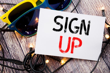 Writing text showing Sign Up. Business concept for Member Register Registration written on sticky note with copy space on old wood wooden background with sunglasses