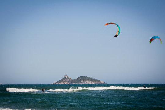 Kitesurfers in action in Barra da Tijuca Beach, Rio de Janeiro