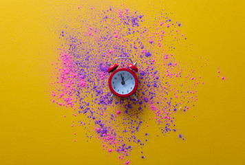 Pink and purple paint and little alarm clock
