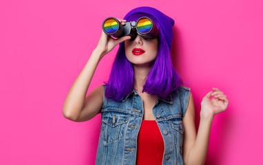 Girl with purple hair and with binoculars
