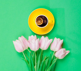 Cup of english tea with spring tulips