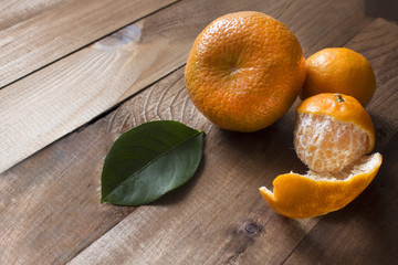 on a pile a large sweet juicy fragrant mandarin with peeled small