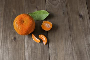 one large juicy aromatic mandarin with peeled lobules