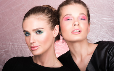 Fashion portrait of two beautiful young women. Bright professional makeup