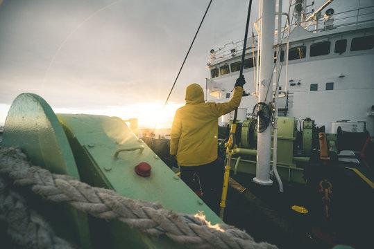 Man standing on Deck of Expedition Vessel - Antarctica
