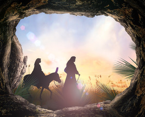 Christmas religious nativity concept: Silhouette mother Mary and father Joseph looking Jesus born in birth manger - 3d illustration