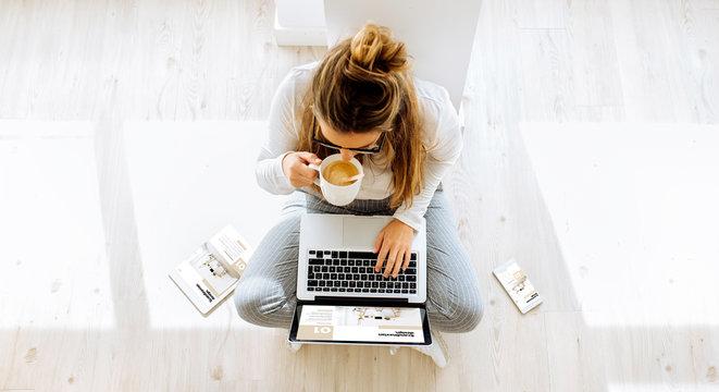 top view of woman working on responsive website scandinavian blog