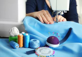 Woman threading modern sewing machine, closeup