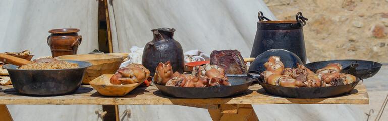 Fried pork knuckles on metal plates. Traditional German food.
