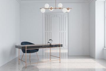 White home office, dark blue armchair