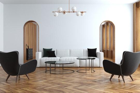 White living room, white sofa, armchairs