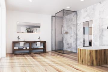 Modern bathroom corner with a wooden tub