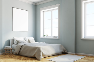 Gray bedroom corner with a poster
