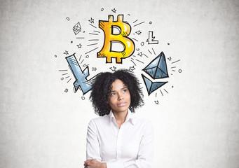 Pensive African American businesswoman, bitcoin