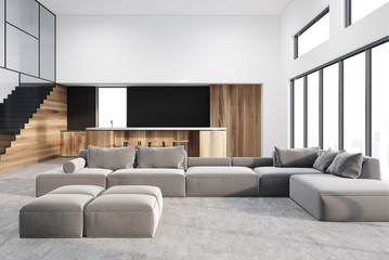 White living room and kitchen, gray sofa