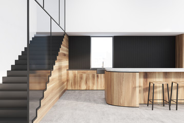Functional white, black, wooden kitchen interior