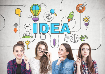 Four teen girls thinking together, idea