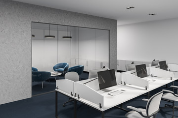 Concrete and white office cubicles