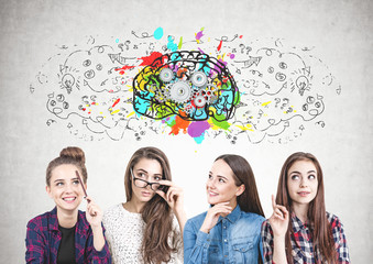 Four teen girls thinking together, cog brain