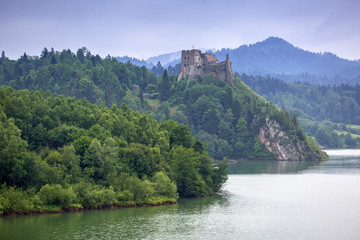 Medieval Czorsztyn castle at the lake in Poland
