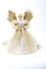 Doll in a golden dress on a white background