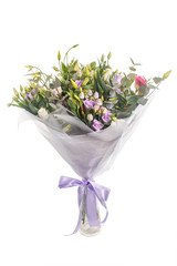 Bouquet of lilac, violet, eustoma and eucalyptus. Delicate and lightweight, packed and with ribbon. A holiday, a gift for a woman. Big and smart. Side view. Isolated.