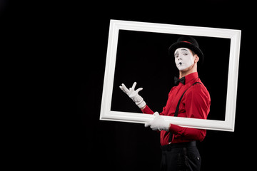 elegant mime gesturing in frame isolated on black
