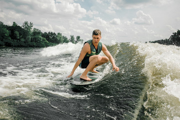 man performs his professional abilities and skills with wakeboard