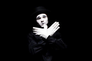 mime showing bird with hands isolated on black